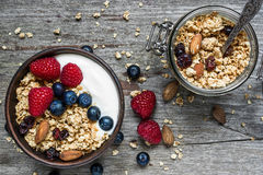 Homemade granola with greek yogurt, nuts and fresh berries in a Stock Image