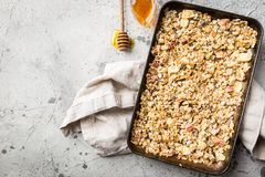 Homemade Granola with honey. Homemade Granola with oat, honey and nuts in a baking tray, top view Stock Image