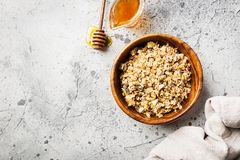 Homemade Granola with honey. Homemade Granola with oat, honey and nuts in a bowl, top view Stock Image