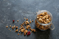 Homemade granola in jar. On dark background with copy space for text. Top view Stock Photography