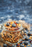 Homemade granola in jar and fresh blueberry Royalty Free Stock Images