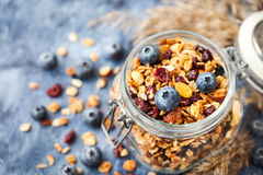 Homemade granola in jar and fresh blueberry Stock Photo