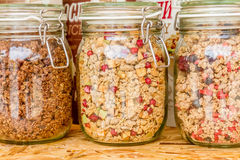 Homemade granola in jar on rustic kitchen table, healthy breakfa. St of oatmeal muesli, nuts, seeds and dried fruit Stock Photography