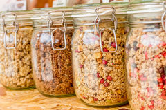 Homemade granola in jar on rustic kitchen table, healthy breakfa. St of oatmeal muesli, nuts, seeds and dried fruit Stock Images