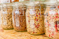 Homemade granola in jar on rustic kitchen table, healthy breakfa. St of oatmeal muesli, nuts, seeds and dried fruit Royalty Free Stock Image