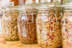 Homemade granola in jar on rustic kitchen table Stock Image