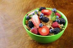 Homemade granola muesli with berries (strawberries, raspberries, blueberries) Stock Images