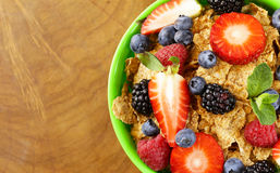 Homemade granola muesli with berries (strawberries, raspberries, blueberries) Royalty Free Stock Images