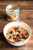 Homemade granola or muesli with toasted peanuts, blackberry and black and red currant in a bowl for healthy breakfast Stock Image
