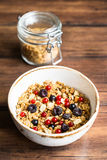 Homemade granola or muesli with toasted peanuts, blackberry and black and red currant in a bowl for healthy breakfast Royalty Free Stock Photography