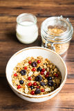 Homemade granola or muesli with toasted peanuts, blackberry and black and red currant in a bowl for healthy breakfast Stock Photos