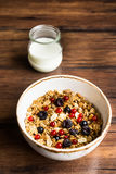 Homemade granola or muesli with toasted peanuts, blackberry and black and red currant in a bowl for healthy breakfast Stock Photography