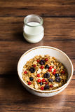 Homemade granola or muesli with toasted peanuts, blackberry and black and red currant in a bowl for healthy breakfast Stock Images