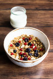Homemade granola or muesli with toasted peanuts, blackberry and black and red currant in a bowl for healthy breakfast Royalty Free Stock Photo