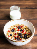 Homemade granola or muesli with toasted peanuts, blackberry and black and red currant in a bowl for healthy breakfast Stock Photo