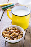 Homemade granola and mug of milk Royalty Free Stock Images
