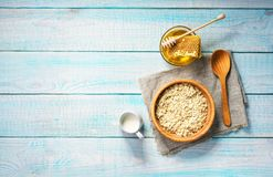 Healthy breakfast with oat flakes, natural milk and honey.  Rust Royalty Free Stock Photography