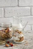 Homemade granola and natural yoghurt on a light wooden surface. Healthy food, healthy Breakfast Royalty Free Stock Photo
