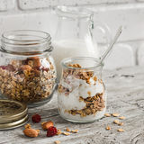 Homemade granola and natural yoghurt on a light wooden surface. Healthy food, healthy Breakfast Royalty Free Stock Photography