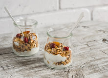 Homemade granola and natural yoghurt on a light wooden surface. Healthy food, healthy Breakfast Stock Images