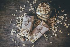 Homemade Granola with Nut Mix In Jar on wooden board on stone table background. Healthy Food Concept. royalty free stock photo