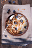 Homemade granola with nuts, candied oranges, fresh blueberries, yogurt and honey Royalty Free Stock Photography