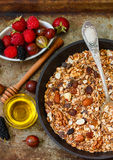 Homemade granola with nuts, honey and fresh berries - raspberries, strawberries, mulberries, gooseberries. Healthy Breakfast. Homemade granola with nuts, honey Stock Image