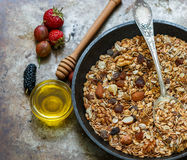 Homemade granola with nuts, honey and fresh berries - raspberries, strawberries, mulberries, gooseberries. Healthy Breakfast. Homemade granola with nuts, honey Stock Photos