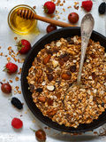 Homemade granola with nuts, honey and fresh berries - raspberries, strawberries, mulberries, gooseberries. Healthy Breakfast. Homemade granola with nuts, honey Stock Images