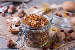 Homemade granola with nuts and seeds in glass jar for healthy breakfast royalty free stock photos