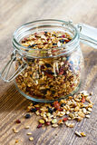 Homemade granola in open glass jar. On rustic wooden background royalty free stock photos