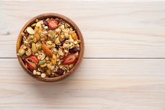 Homemade granola in bowl rustic background. Copy space. stock image