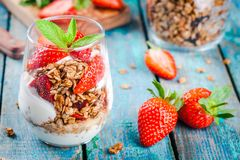 Homemade granola parfait with strawberry and mint Royalty Free Stock Photos