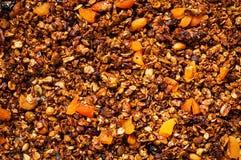 Homemade granola with raisins, walnuts, almonds and hazelnuts. Muesli. Healthy Breakfast. Top view. Stock Photos