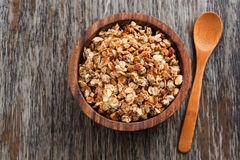 Homemade granola in a wooden bowl and spoon, top view Stock Photography