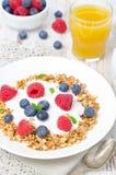 Homemade granola with yogurt, raspberries, blueberries and juice Stock Photography