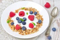 Homemade granola with yogurt, raspberries and blueberries Royalty Free Stock Photo