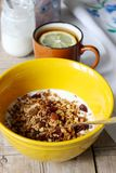 Homemade granola with yogurt and tea with lemon. Useful breakfast. Rustic style, selective focus. Stock Photography