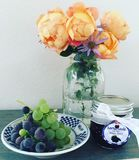 Homemade grape jelly. And roses display for breakfast Stock Photos