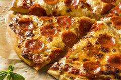 Homemade Greasy Pepperoni New York Pizza. Ready to Eat royalty free stock photography
