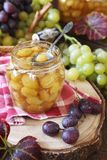 Homemade green grapes confiture in jar and berry Royalty Free Stock Photo