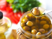 Homemade green olives. close-up of organic olives and olive oil in jar stock images