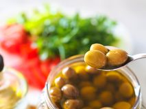 Homemade green olives. close-up of organic olives and olive oil in jar royalty free stock images