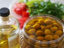 Homemade green olives. close-up of organic olives and olive oil in jar royalty free stock photos