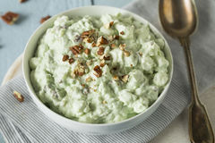 Homemade Green Pistachio Fluff Dessert. With Pecans and Marshmallows Stock Photo
