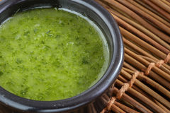 Homemade green sauce in a stone bowl with parsley, garlic, olive oil and salt Royalty Free Stock Photos
