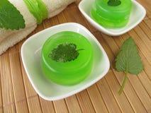 Homemade green soap. With lemon balm stock photos