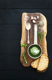Homemade green spinach cream-soup in a metal scoop Stock Photos
