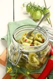 Homemade green tomatoes preserves in glass jar Royalty Free Stock Photography