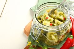 Homemade green tomatoes preserves in glass jar Stock Photos